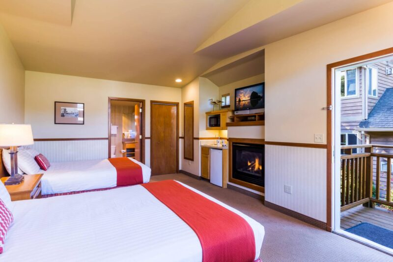 Deluxe double queen room with a fireplace